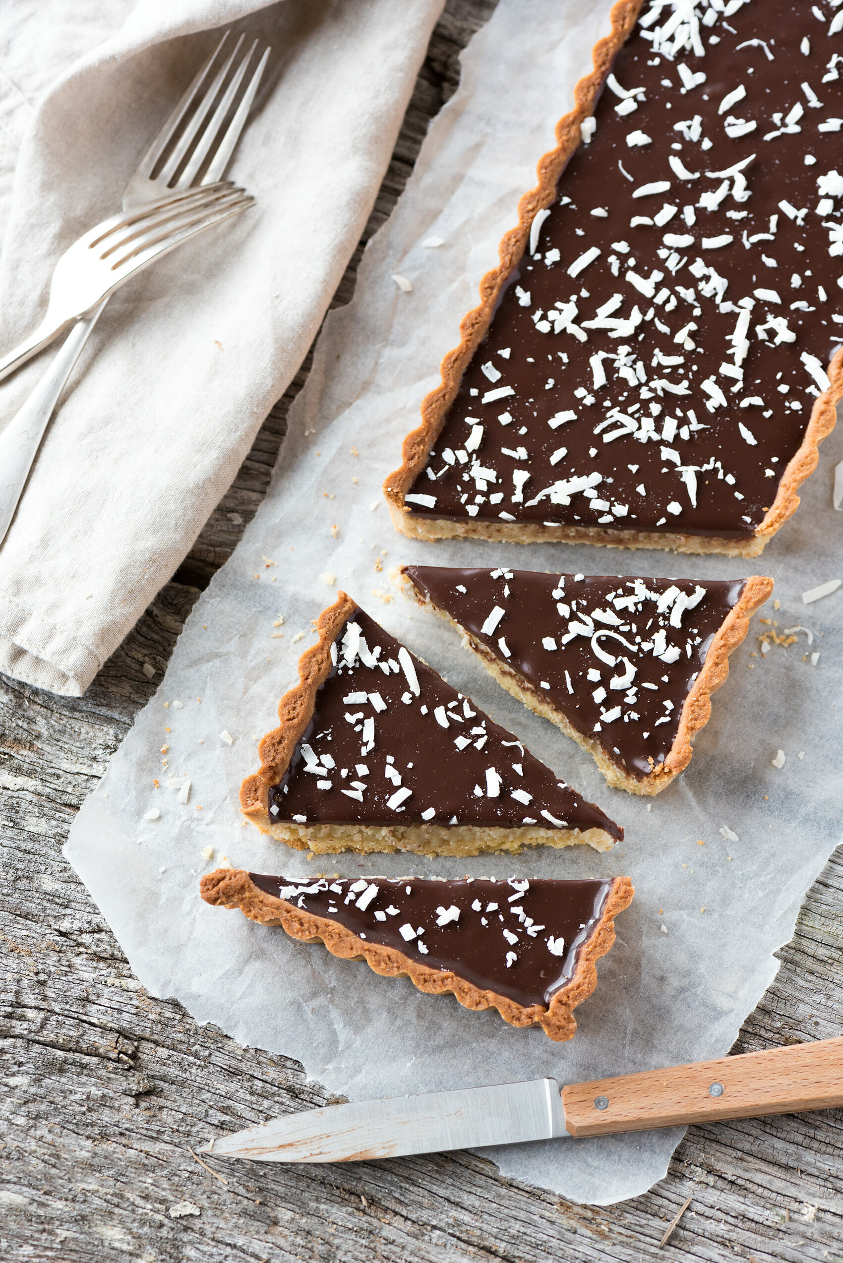 Tarte Noix de Coco, Chocolat, Amandes | Lilie Bakery